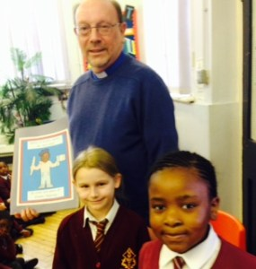 Reverend Marshall is presented with his book.